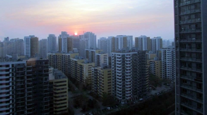 China skyscraper skyline with multiple shabby looking apartment buildings across the horizon