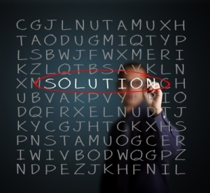 Man doing a word find puzzle and circling the word solution