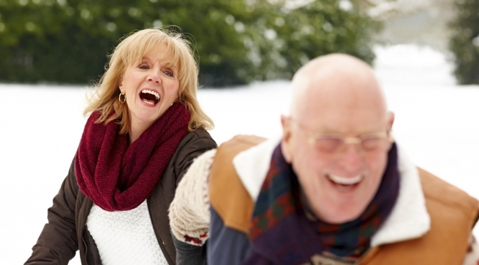Senior couple enjoying themselves in winter forest