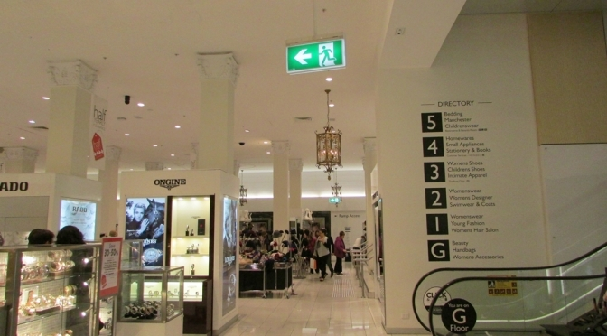 Melbourne Department Store exit sign in front of escalator