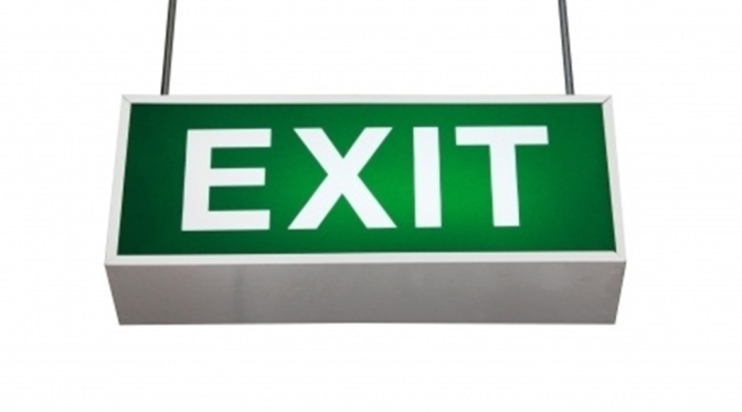 Old style exit sign with white lettering saying EXIT on green sign