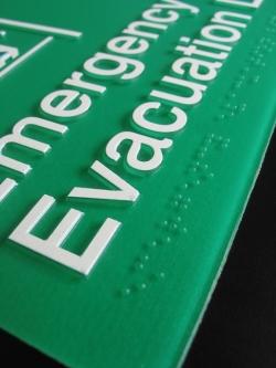 Emergency Evacuation Lift Sign Close Up